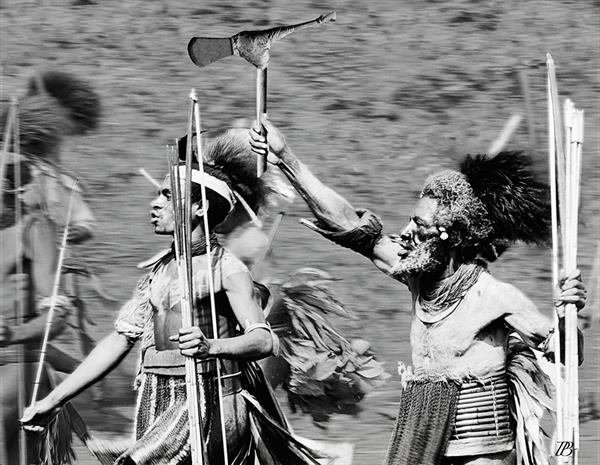 Tribesmen charging. Papua New Guinea. 1972 by Peter Bowater