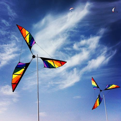 Coloured Windmills by Christian Rose