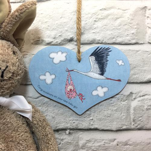 Baby girl glossy vinyl print heart shaped plaque by Lisa-Marie Davies