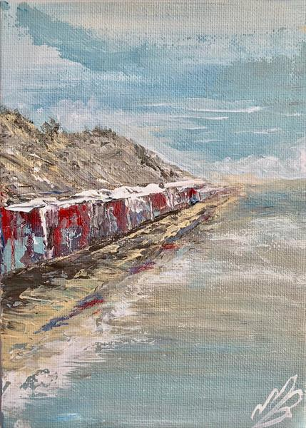Beach huts under the cliff by Marja Brown