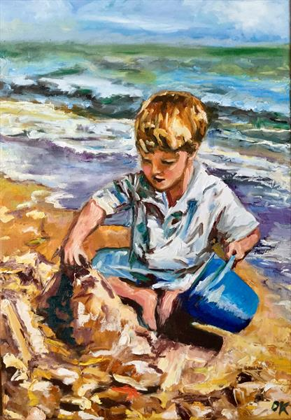 Boy is playing on the seaside. Childhood.  by Olga  Koval